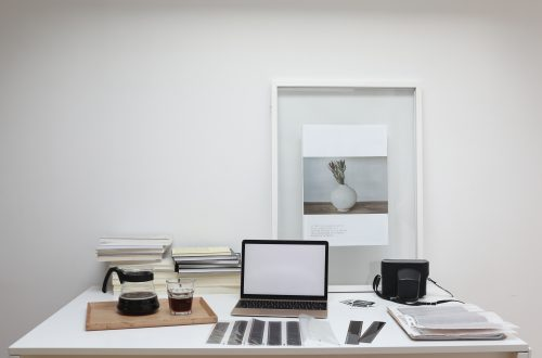 Creative workplace with laptop and film camera