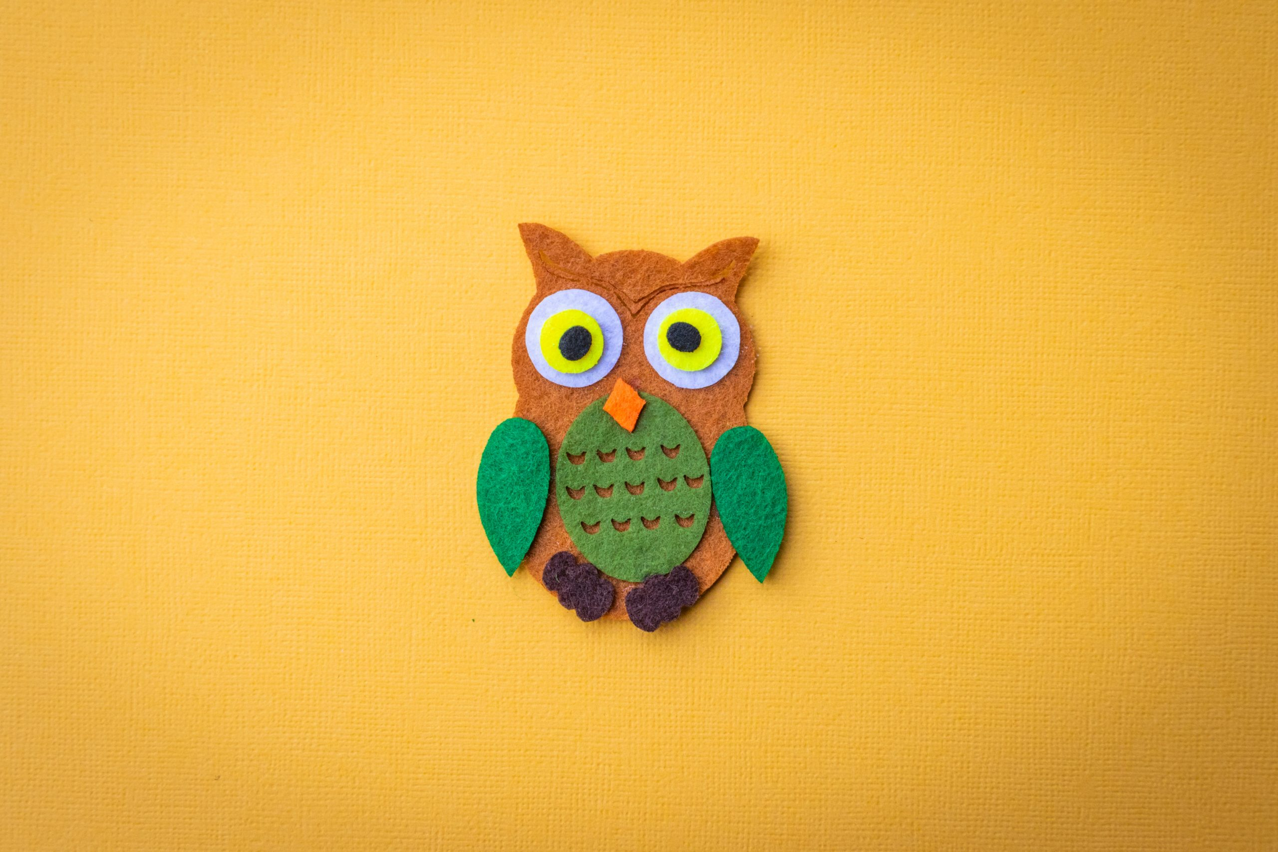 Brown and green owl patch